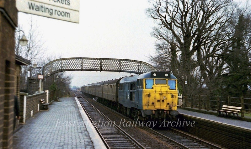 31411 roars through Meldreth with the 1130 Cambridge to Kings Cross on 28th January 1978.
