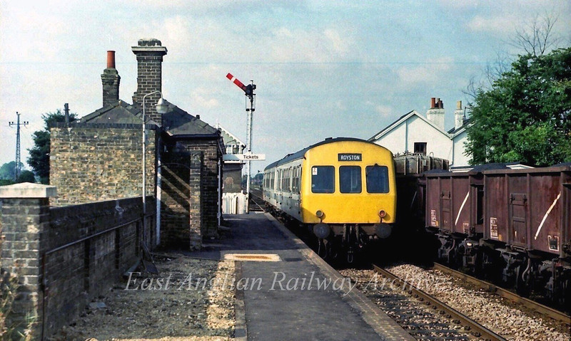 The scene at Foxton on 4th September 1979. The 1010 Cambridge to Royston with a Class 101 is passing and on the down line out of site 37011 is manouvering a freight into Barrington Cement Works Siding.