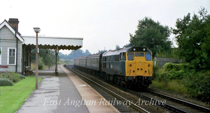 31243 passes Elsenham with the 0936 Liverpool Street to Cambridge.  31st August 1979