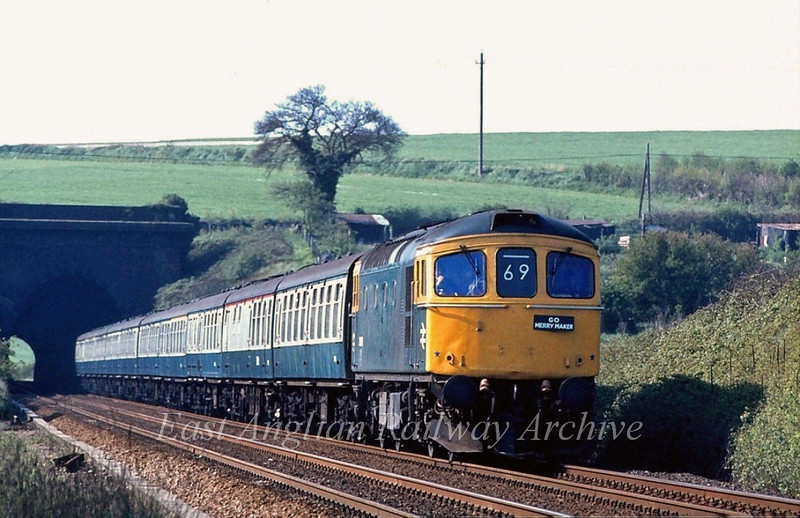 33030 leaves Littlebury Tunnel with a Wokingham to Spalding Merrymaker.  10th May 1980. The engine was stabled at Cambridge for the day.