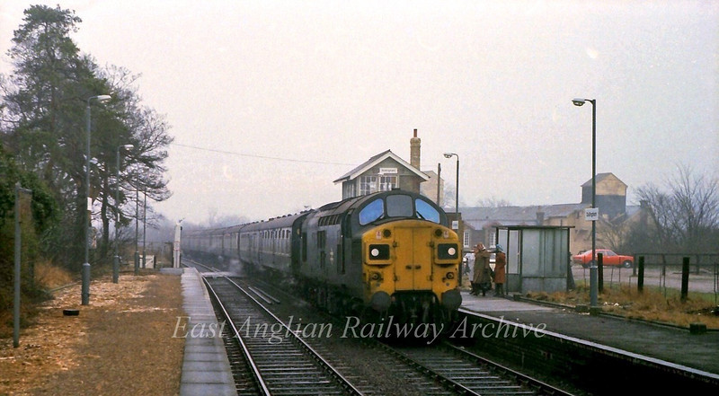 Time was, when even small village stations such as Dullingham had a through hauled service to Liverpool Street.  37110 arrives, in charge of the 0712 Ipswich to Liverpool Street via Cambridge on a cold murky 22nd February 1978.