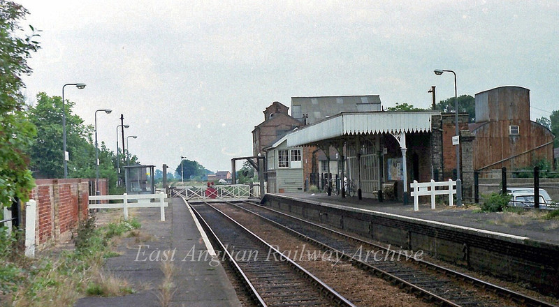 Elmswell looking towards Haughley Junction. The signal box has now disappeared along with the manual crossing gates. 29th August 1978