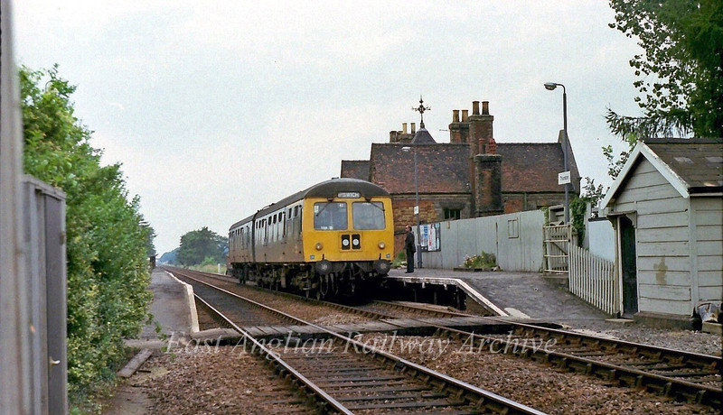 Thurston Station between Bury and Elmswell with a two car Cravens unit forming a Peterborough to Ipswich working.  29th August 1978