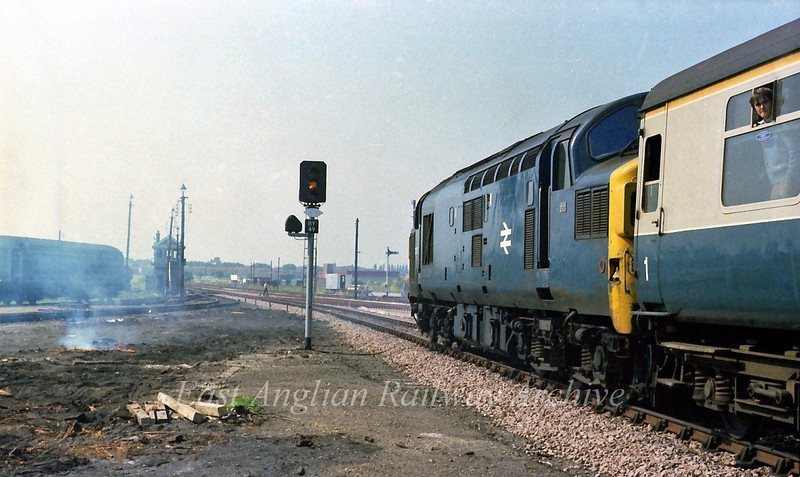 37097 waits to leave Bury St Edmunds with the 1240 Parkeston to Peterborough.  30th August 1979.