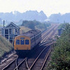 A refurbished class 101 leaves the single line from Warren Hill Tunnel and Newmarket and joins the line from Ely at Chippenham Junction. The working is the 1250 Cambridge to Ipswich on a very hot August 27th 1980.  Taken with a 200mm lens