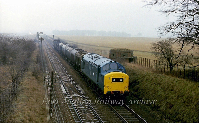In the days of loose coupled freights and brake vans an immaculate 37178 approaches Chippenham Junction on 22nd February 1978. This was probably a Bury St Edmunds to Whitemoor working.