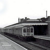 Newmarket  on 21st August 1975 with the 0953 Cambridge to Ipswich arriving. The supurb canopy on the down platform has long gone. This part of the platform is now disused.