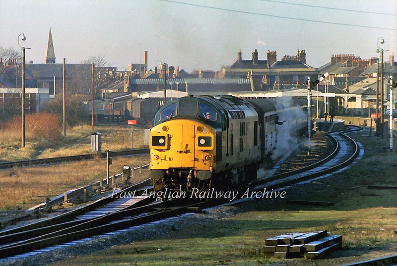 On a very cold and frosty 31st December 1979 and steam billowing from the carriage heating 37087 departs from Kings Lynn with the 1137 to Liverpool Street.