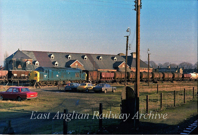 37035 arrives in KIngs Lynn Goods Yard with a mixed freight.  31st December 1979. This area is now a Morrisons Supermarket.