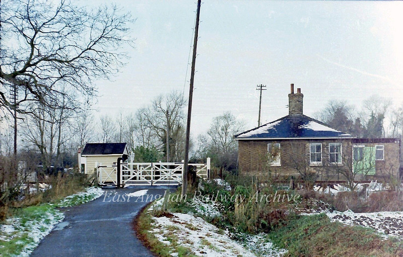 Milton Crossing on 28th November 1978. This is a minor road leading down to the River Cam at Baits Bite Lock. In the summer months it is very busy and the crossing keeper must have had a very disruptive life opening and shutting the gates for traffic before the crossing became automatic. AHB.