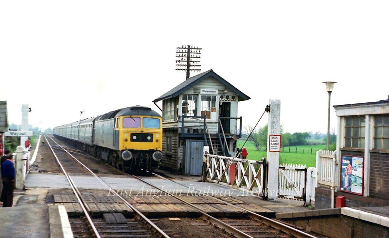 47054 passes Waterbeach with empty coaching stock for the Spalding Flower Festival.  The Western Region stock had been stabled at Cambridge for the day.   12th May 1979