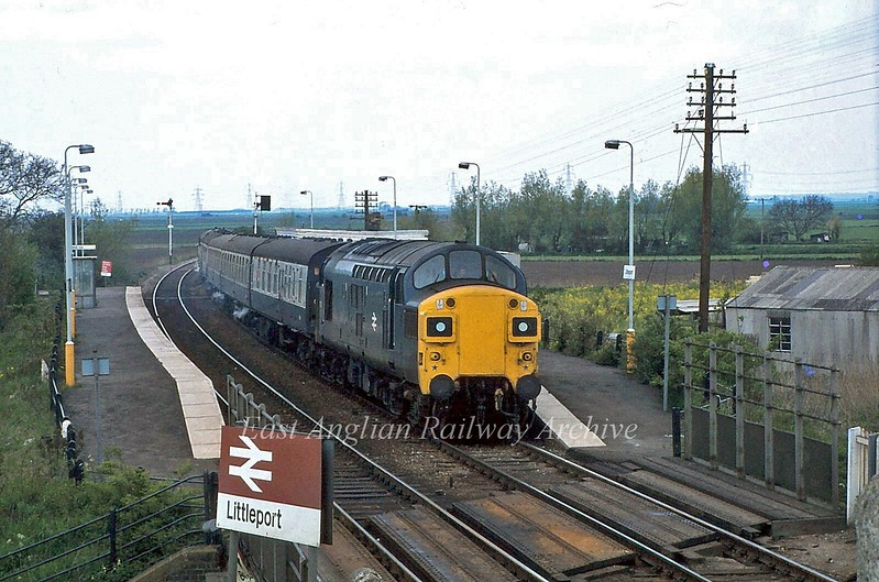 37035 stands at Littleport with the 1130 Kings Lynn to Liverpool Street, viewed from the signal box.  5th May 1980.