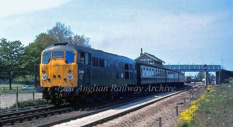 31108 departs Kings Lynn with the 1330 to Liverpool Street.  17th May1980