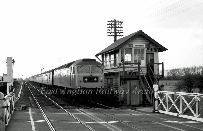 An unknown class 47 passes Waterbeach Signal Box. December 1980.