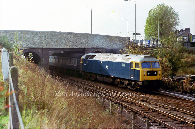 47018 passes under Newmarket Road Bridge near Barnwell Junction with the 1036 Liverpool Street to Kings Lynn.  4th November 1978