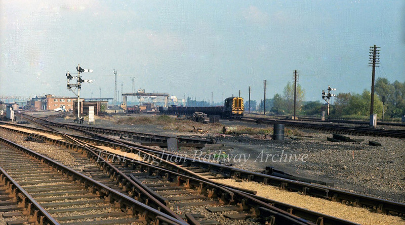 "Chesterton Junction permanent way depot on 27th October 1978 with 08052 on shunting operations. This area is to be the site for a new station ""Cambridge Science Park"" The line to St Ives is to the left. The route of the Fen Drayton sand train can be clearly seen."