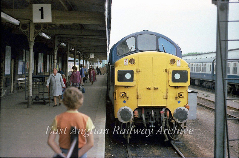 37050 stands at the buffer stops at KIngs Lynn after bringing in the 1436 from Liverpool Street.  17th August 1978