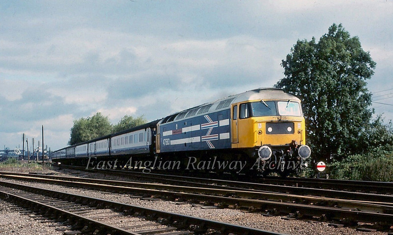 47583 passes Chesterton Junction, Cambridge.  The livery is Stratford's contribution to the royal wedding of Charles and Diana.  Photo dated August 1981.