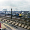 Cambridge North viewed from Mill Road Bridge.  The 1036 Liverpool Street to Kings Lynn is departing behind 37050  18th November 1978