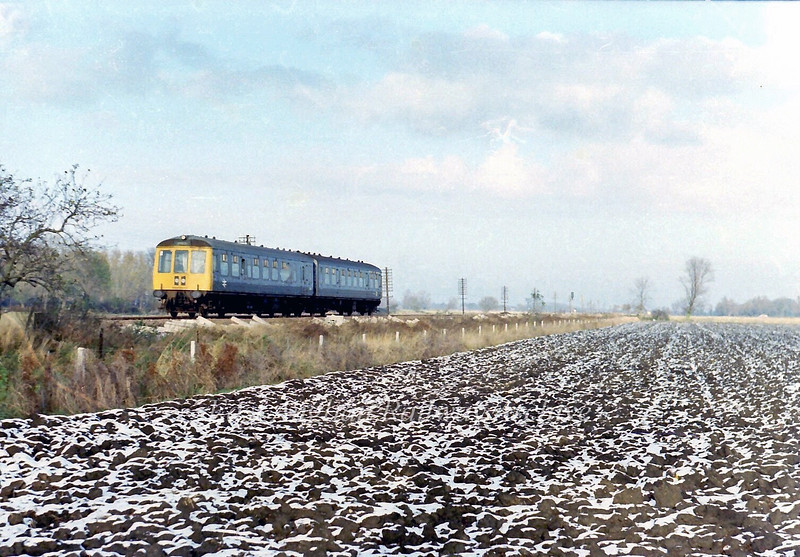 1029 Doncaster to Cambridge crosses a bleak landscape near Milton Crossing between Waterbeach and Chesterton Junction.  28th November 1978.
