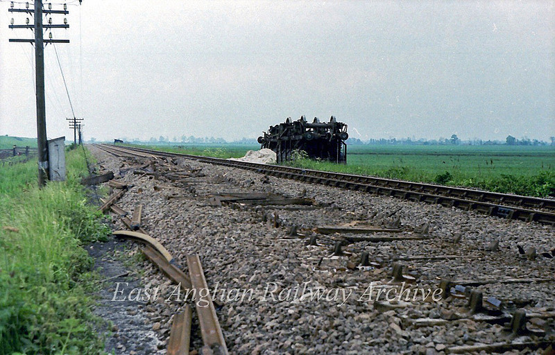 Whoops. The scene at Sandhill Crossing, Littleport after a Middleton Towers to Doncaster sand train had become derailed and ripped up the Up line the previous evening.  9th June 1979