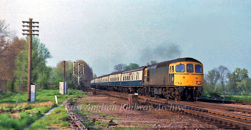 The Spalding Flower Festival often brought some interesting motive power to the area. Here 33053 is on a return Merrymaker to Brighton, approaching Ely North Box on 12th May 1979.