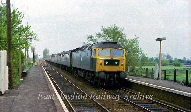 47155 passes Waterbeach with the 1325 Kings Lynn to Liverpool Street.  12th May 1979
