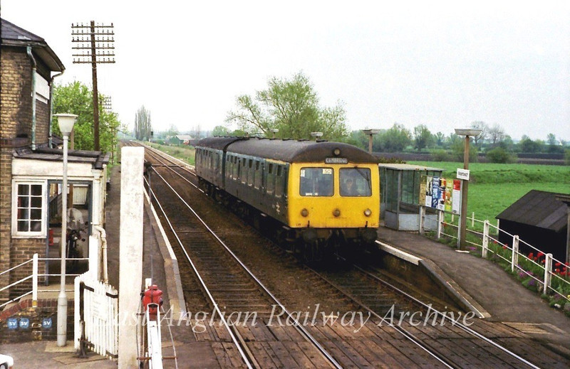 Cravens two car unit passes Waterbeach viewed from the signal box.  12th May 1979