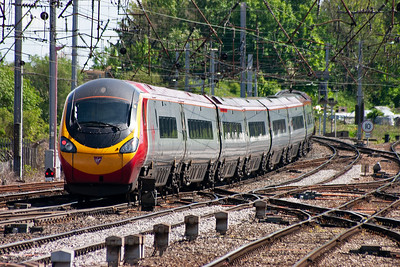 Its station work done, 390041 gather speed as it departs Citadel station heading for London.
