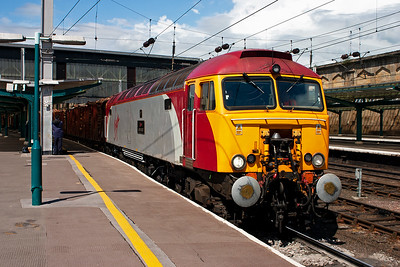 57305 reappears with a load of 13 well filled KFA timber wagons in tow. The loco is on hire to Colas Rail and it it is working 6J37 1251 FX Carlisle Yard to Chirk loaded timber. Korospan have a plant at Chirk for making timber products.