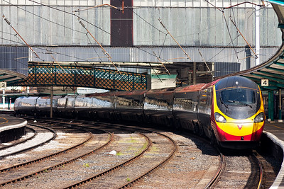 The staple diet of WCML traffic at Carlisle is formed by class 390 Pendolino units. 390025 emerges from under the train shed with 1M10 0940 Glasgow Central to Euston.