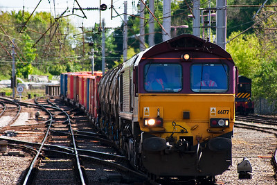66177 comes off the Maryport line with the late running 6C28 1202 TThO Workington to Carlisle Yard enterprise. It was running about 2 hours down. It is very well loaded with 5 china clay slurry tanks and 28 containers.