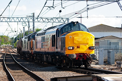 Another freight comes in from the Maryport line. Immaculate DRS type 3's 37610 and 37605 haul a pair of soda tanks towards Carlisle Kingmoor, 6C42 1338 ThO from Sellafield.