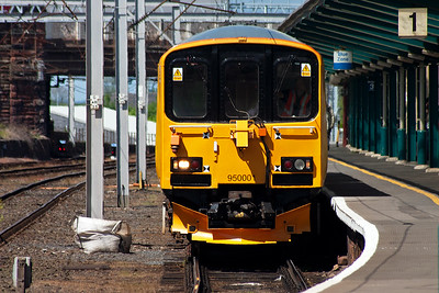 950001 comes south through platform 1 and will stable in Wapping Sidings in front of Carlisle signalbox.