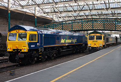 66841 was dispatched from Glasgow's Springburn Works the previous day but only got as far as Carlisle when it failed with a traction motor fault, will return to Springburn Works at 1015. Meanwhile 66581 passes by working 6E73 0447 MX Killoch to Ferrybridge Power Station loaded coal.