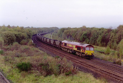 A move to Greenhill Lower Junction now and first to be seen is 66020 and a rake of loaded coal hoppers forming 7G80 0756 Hunterston to Longannet Power Station.