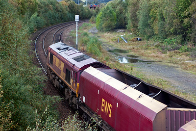 I was caught out by this as I didn't hear it coming and was looking the other way! 66206 works a rake of empty HTA coal hoppers with 4J06 1106 Longannet Power Station to Hunterston empty coal hoppers. 2/10/2010