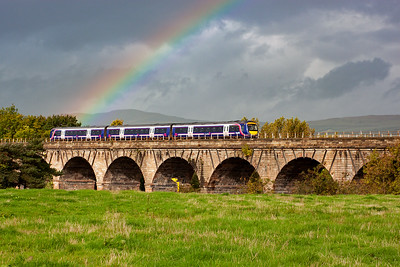 An unknown class 170 turbostar passes over Castle Cary Viaduct below a rainbow with 1A59 1041 Glasgow Queen Street to Aberdeen. Is the pot of gold in the back cab? 2/10/2010