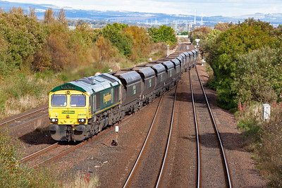 The lengthy train crosses over the down line and takes the road to Cumbernauld. On arrival Carstairs it will recess and move off to wherever it is required for reloading.