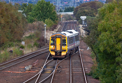 158706 takes the pointwork to gain the Cumbernauld road with 2J65 1443 Falkirk Grahamston to Glasgow Queen Street class 2 working.