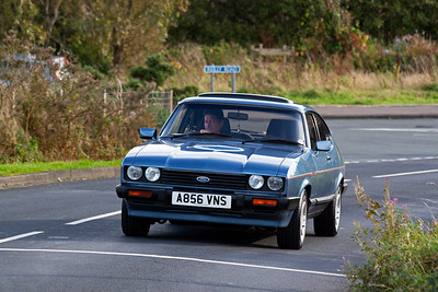 An immaculate Ford Capri Laser approaches on the road. Taken for my son Ross who also has a Capri Laser.