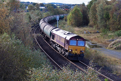 More freight action and 66174 comes up the 1 in 110 gradient with the empty bogie tanks from the distribution depot at Dalston on the Maryport line in Cumbria. The train is 6S36 0847 Dalston to Grangemouth empty bogie tanks.