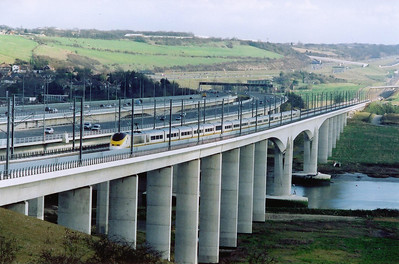 The impressive viaduct leaps across the River Medway carrying the CTRL high above the waters. 3003/4 tear across the structure with 9141 1456 Brussels to London.