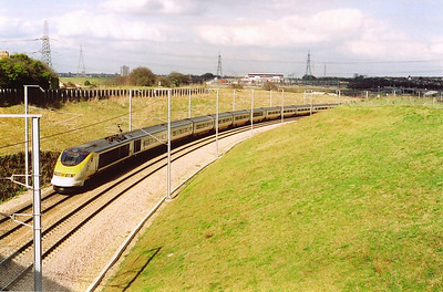 In glorious warm spring sunshine 3220/19 passes below with 9140 1442 London to Brussells.