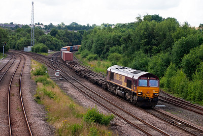The first freight of the day appears behind 66100 working 4E69 Washwood Heath to Wakefield Europort intermodal.