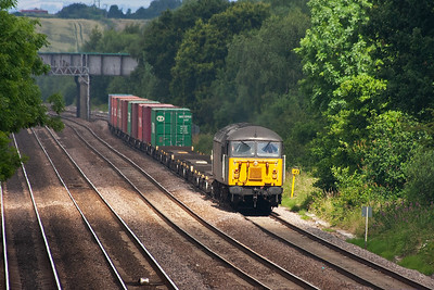Tupton is located a mile or so to the north of Clay Cross Junction and another welcome sight appears heading south, refurbished type 5 Grid 56303 catching a patch of sunlight through the trees at milepost 143 from........