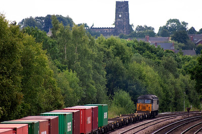 A going away shot of 56303 as it passes below the tower of St Lawrence church, North Wingfield.