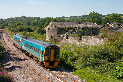 Arriva sprinter 158820 passes the derelict Grange and buildings on its journey from Milford Haven to Manchester Piccadilly, 1310 departure 1W85.