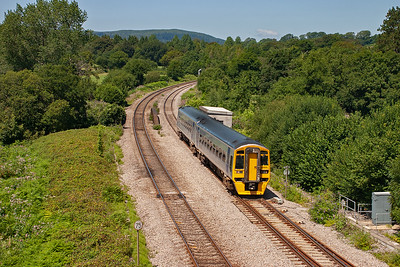Silver 158835 approaches with a Gloucester bound working, 2G60 1217 off Maesteg.