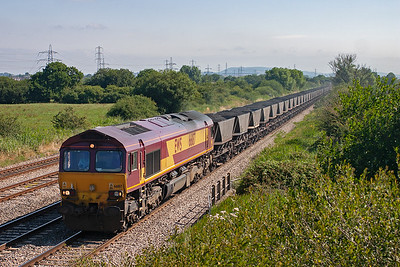 66187 hauls 36 well loaded HAA coal hoppers along the Down Relief road forming 6F66 0700 Newport Docks to Aberthaw Power Station which is near Barry.